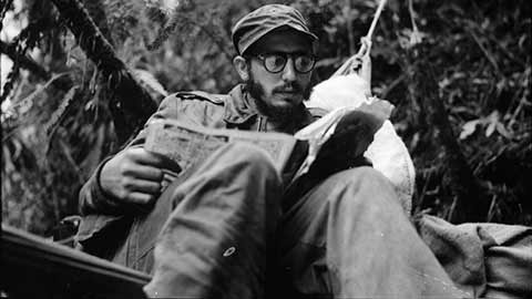 Fidel Castro catches up on the news at an outpost in the Sierra Maestra.
